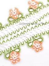 タオルの縁飾り:メキッキ|花:サーモン✕グリーン