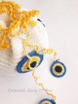 手編みナザルボンジュウのミニ巾着|白色×卵
